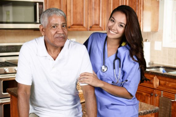 45930398 - home health care worker and an elderly man